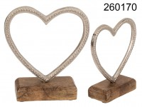 Metal heart with embossing on wooden base, ca. 14 ...